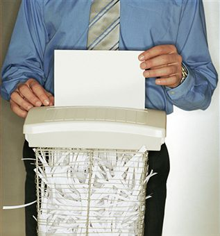 man-shredding-paper